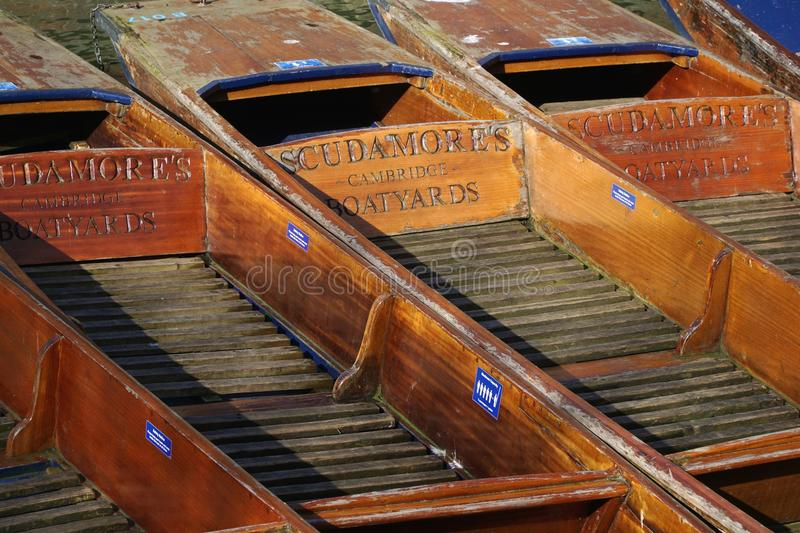 Punt Close-Up, Cambridge, England. CAMBRIDGE, UK - FEBRUARY 24 2016: Several punts belonging to Scudamore's punting company, Cambridge, England, sit empty on a royalty free stock photos