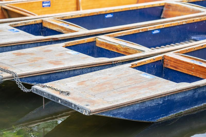 A punt is a flat-bottomed boat with a square-cut bow, designed for use in small rivers or other shallow water. Cambridge, England.  royalty free stock image