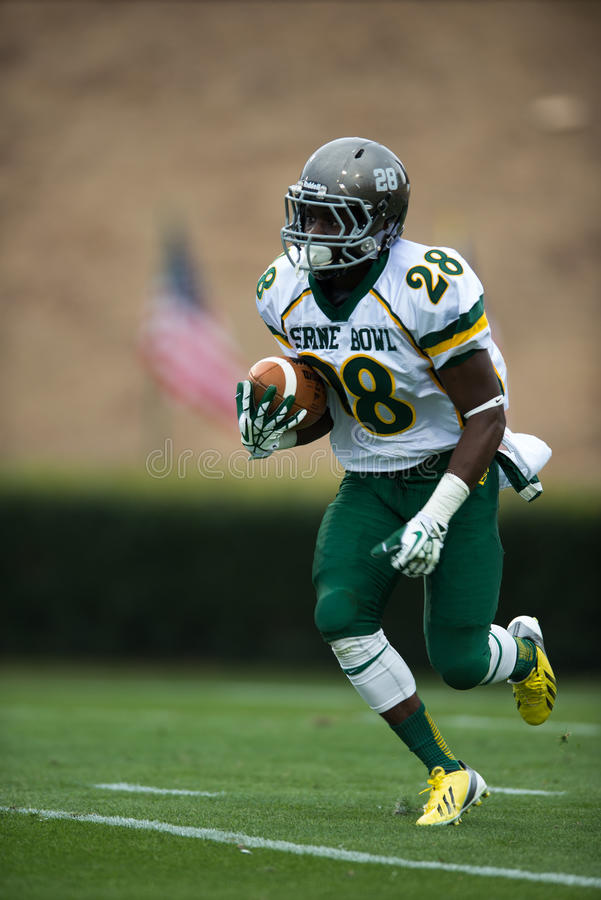Punt Return. Future Duke DB Shaun Wilson returns a punt in the Shrine Bowl of the Carolinas game royalty free stock photo
