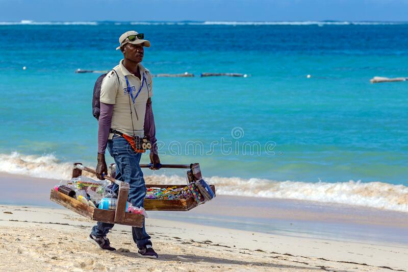 Dominican salesman with souvenirs for sale on the beach royalty free stock photos