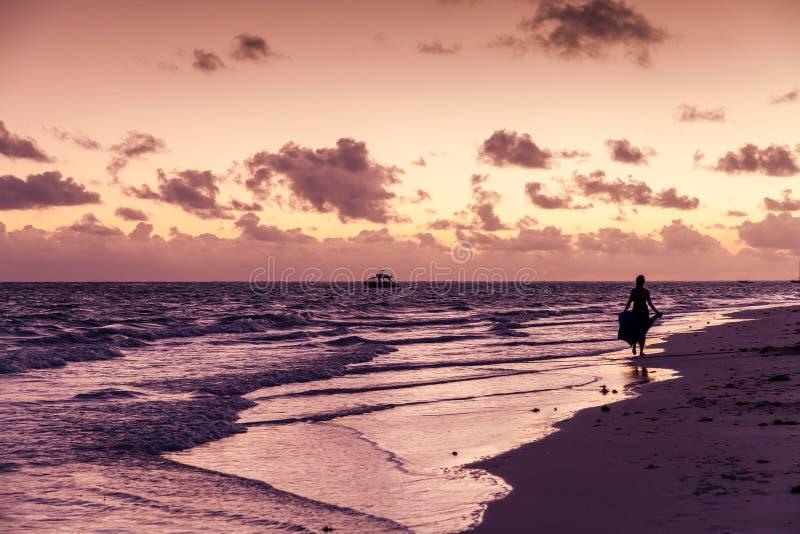 Punta Cana woman walk on wet sand royalty free stock photos