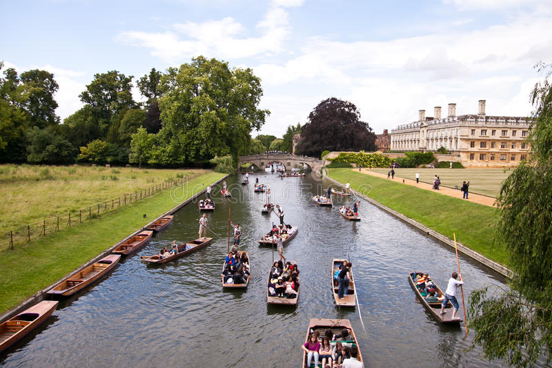 Punter boats passing King s college in Cambridge. Tourists and punters on the river Cam in Cambridge, England, UK stock photos