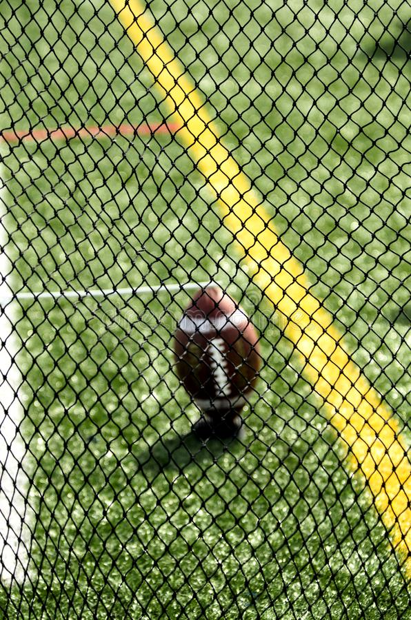 Punter`s Net And Football On Sideline. Football Seen Through Punter`s Net On Field royalty free stock photos