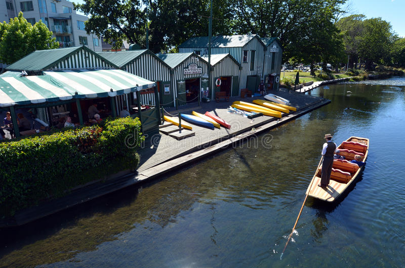 Punting on the Avon river Christchurch - New Zealand. CHRISTCHURCH - DEC 08 2015:Aerial view of People Punting near the Punting boat shed on the Avon river stock image