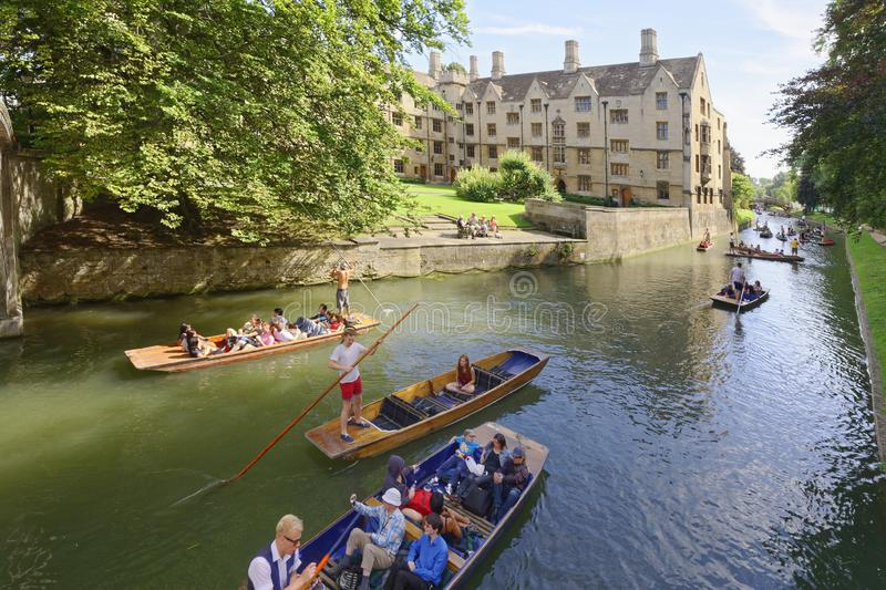 Punting canals Cambridge England. tourists stock image