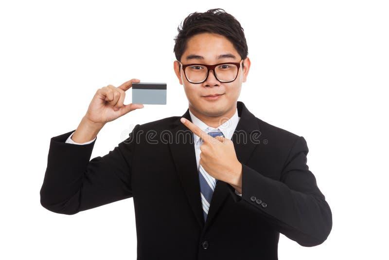 Punto asiatico dell'uomo d'affari ad una carta immagine stock libera da diritti