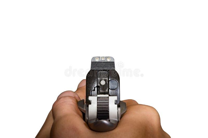 Punto del arma de la mano de la pistola a la blanco foto de archivo