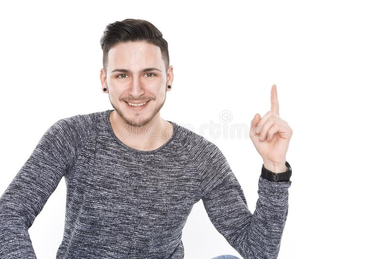 Punto del hombre joven encendido foto de archivo
