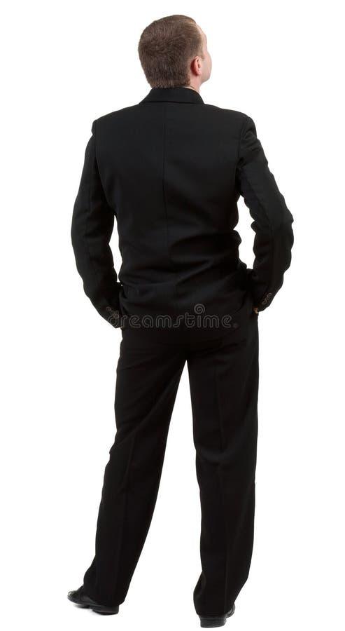 Punto di vista della parte della persona. Vista posteriore. L'uomo d'affari guarda avanti. fotografia stock libera da diritti