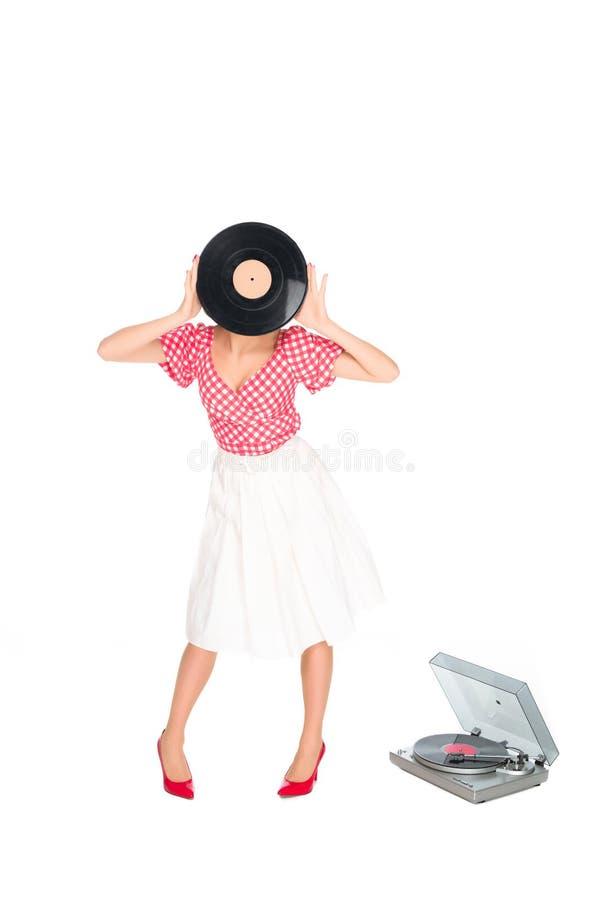 punto di vista oscurato della donna in perno sul fronte della copertura dell'abbigliamento di stile con l'annotazione di vinile fotografie stock libere da diritti