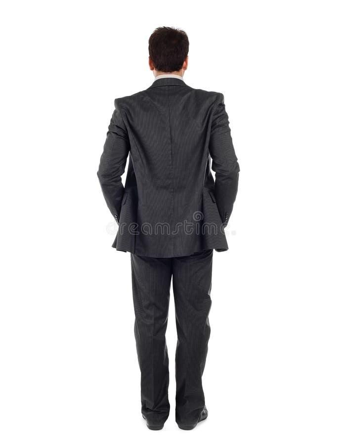 Punto di vista posteriore del corpo intero di un uomo di affari in vestito nero immagine stock libera da diritti