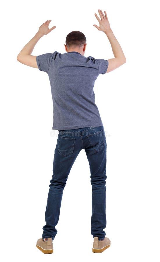 Punto di vista posteriore dell'uomo ballante sorveglianza del tipo immagine stock