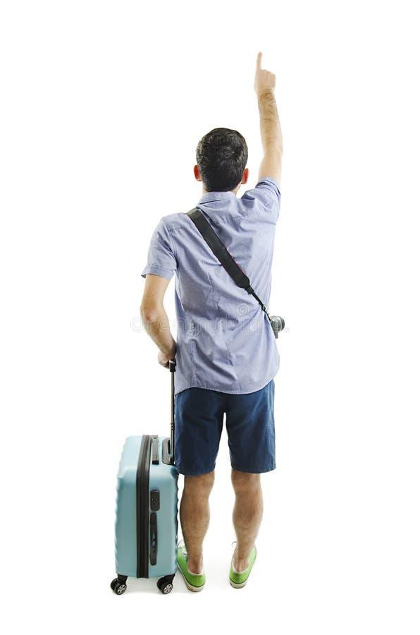 Punto di vista posteriore dell'uomo indicante con la valigia punto di vista della parte della persona tipo con una borsa di viagg fotografie stock libere da diritti