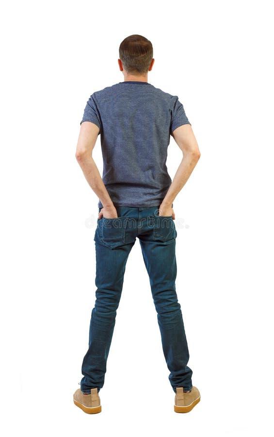 Punto di vista posteriore dell'uomo in jeans scuri Giovane tipo diritto fotografia stock