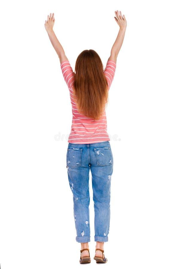 Punto di vista posteriore della donna allegra che celebra le mani di vittoria su fotografia stock