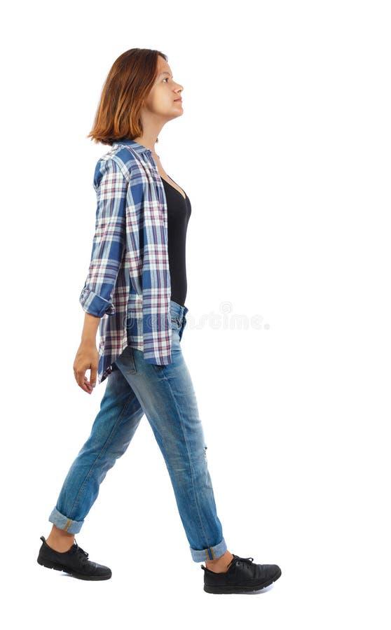 Punto di vista posteriore della donna di camminata fotografia stock libera da diritti