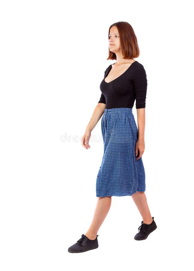 Punto di vista posteriore della donna di camminata fotografia stock