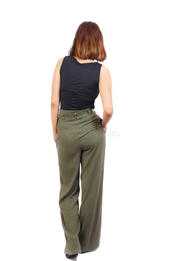 Punto di vista posteriore della donna di camminata fotografie stock