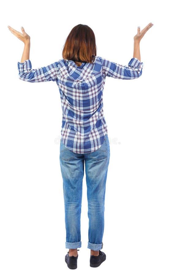 Punto di vista posteriore della donna colpita in jeans fotografia stock libera da diritti