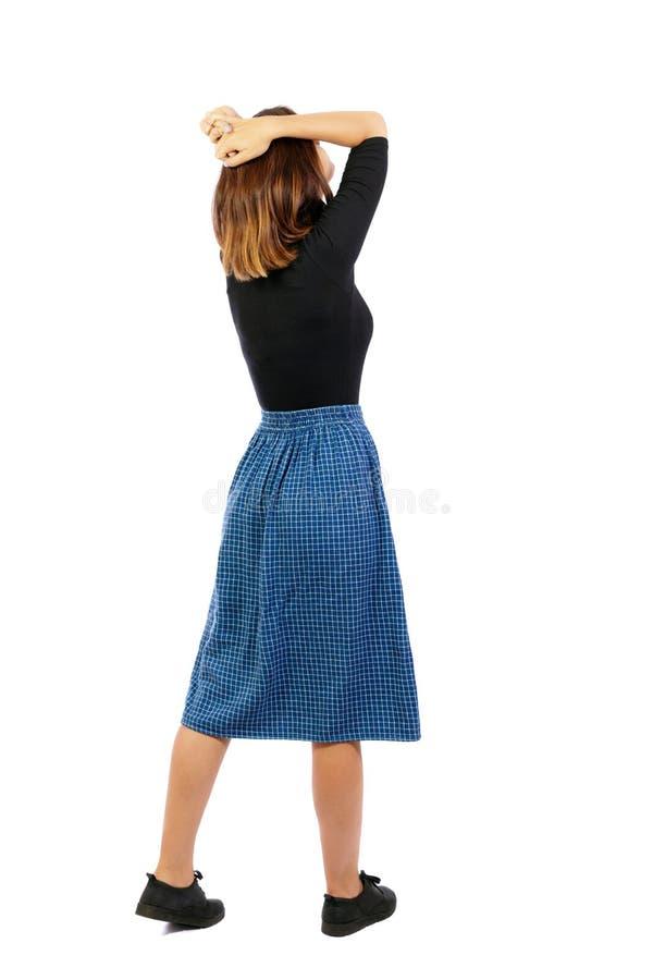 Punto di vista posteriore della donna colpita in vestito immagini stock libere da diritti