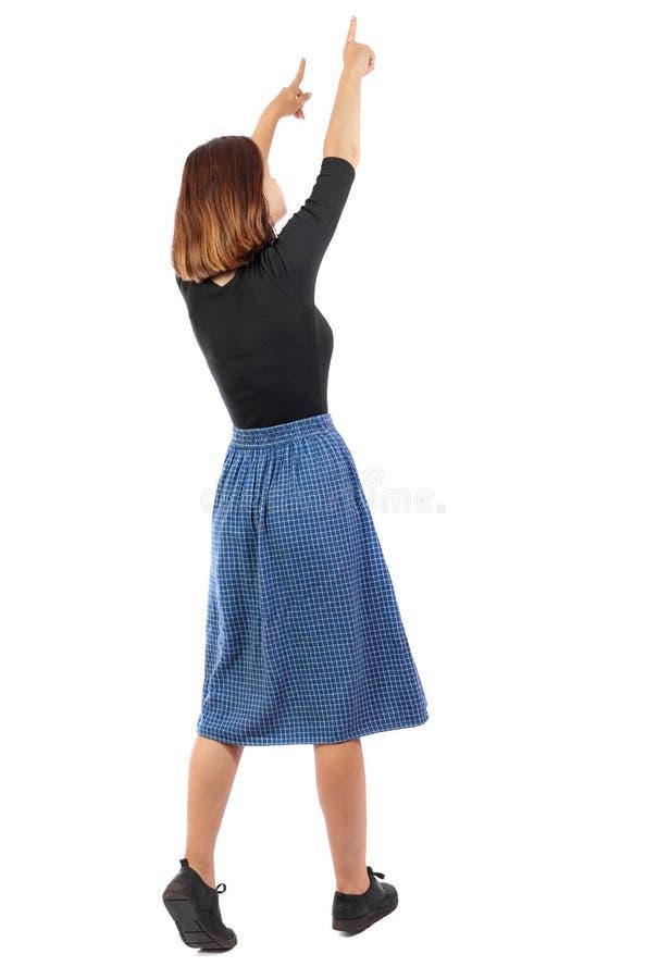 Punto di vista posteriore della donna indicante fotografia stock libera da diritti