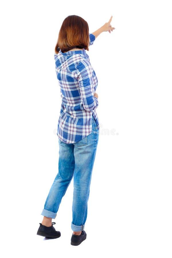 Punto di vista posteriore della donna indicante fotografia stock