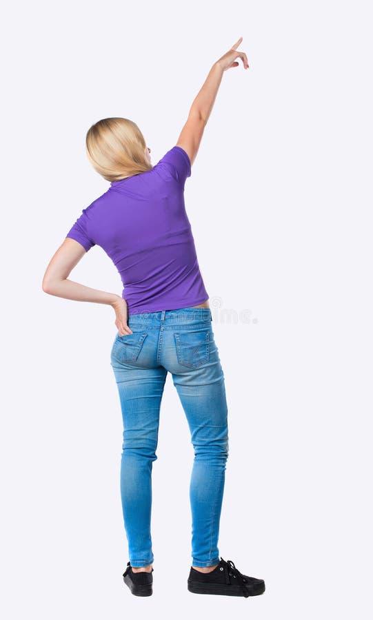 Punto di vista posteriore della donna indicante immagini stock