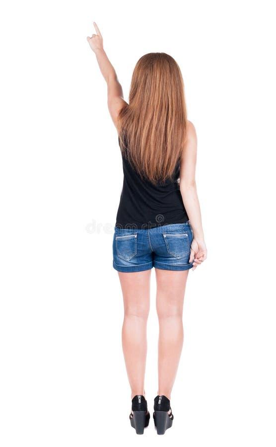 Punto di vista posteriore della donna indicante fotografie stock libere da diritti