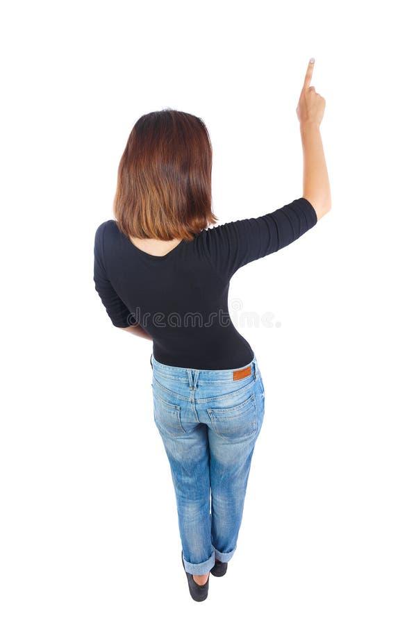 Punto di vista posteriore della donna indicante Bella ragazza fotografia stock