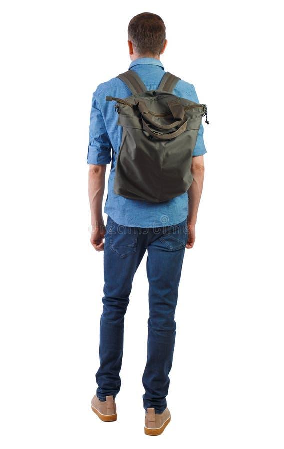 Punto di vista posteriore di un uomo con una borsa verde immagine stock