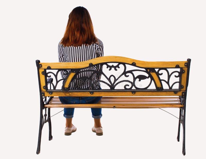 Punto di vista posteriore di una donna che si siede sul banco immagini stock libere da diritti