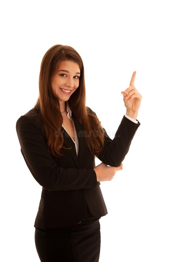 Punto hermoso de la mujer de negocios en el espacio de la copia aislado sobre blanco fotografía de archivo libre de regalías
