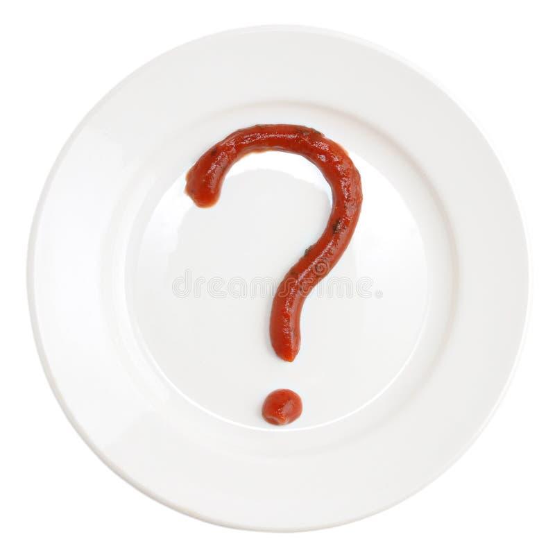 Punto interrogativo fatto del ketchup di pomodoro sulla zolla fotografie stock libere da diritti