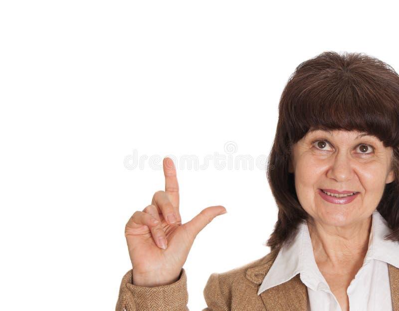 Punto maturo della bella donna di età in dito su Concetto di idea immagini stock libere da diritti