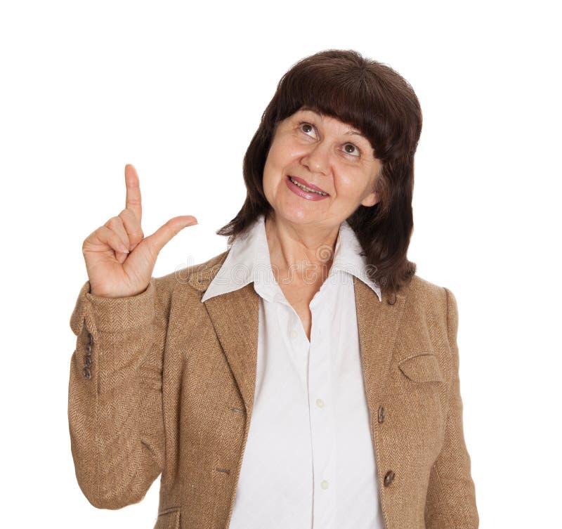 Punto maturo della bella donna di età in dito su Concetto di idea fotografia stock libera da diritti