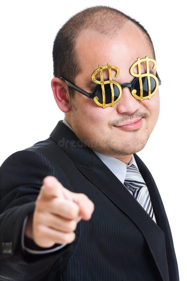 Punto ricco del dito dell'uomo d'affari alla parte anteriore immagini stock libere da diritti