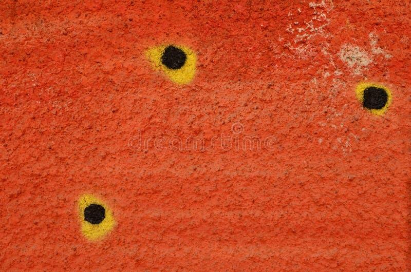 Puntos negros en naranja imagen de archivo
