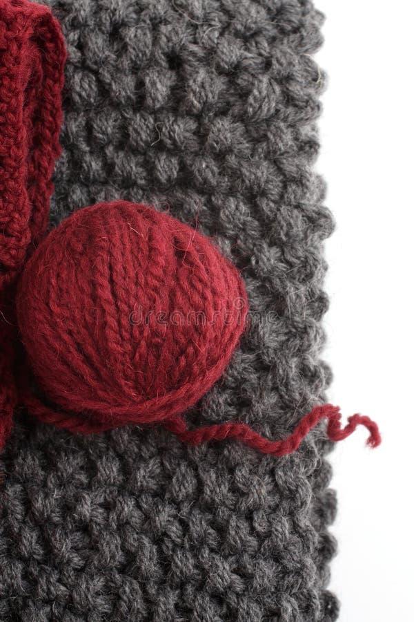 Puntos y una bola de lanas imagen de archivo