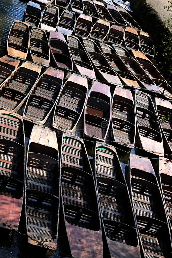 Punts. Tied up wooden river punts on a river in Oxford Great Britain royalty free stock photos