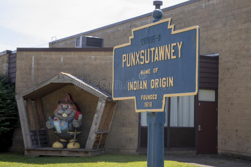 Punxsutawney town sign with Phil dressed as Fireman stock photography