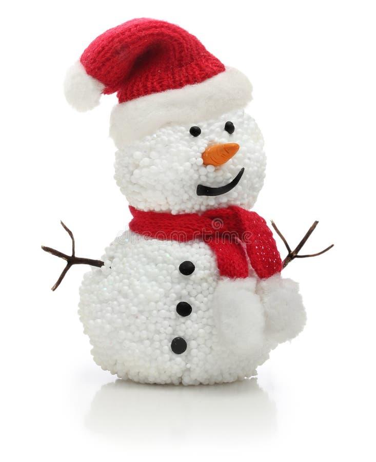 Pupazzo di neve in cappello di rosso di natale di Santa Claus fotografia stock