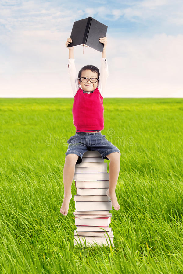 Download Pupil with books outdoor stock photo. Image of grass - 26052266