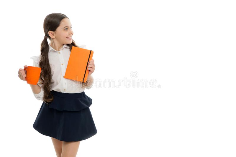 Pupil drink water. Schoolgirl with mug having tea break. Relax and recharge. Water balance. Enjoying tea. More energy. Girl child with long hair drink cocoa or royalty free stock photography