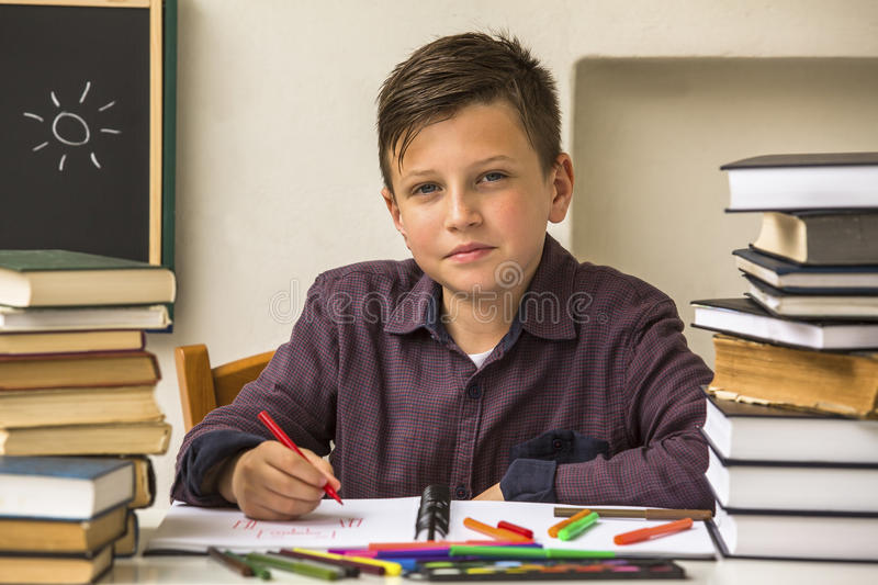 Pupil elementary school does homework. Learning. stock photo