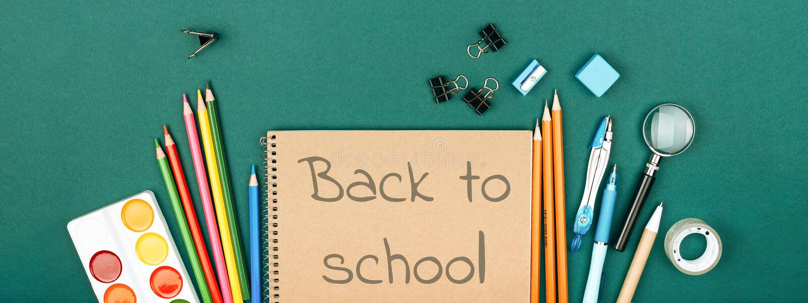 Pupil`s desk with stationary. royalty free stock images