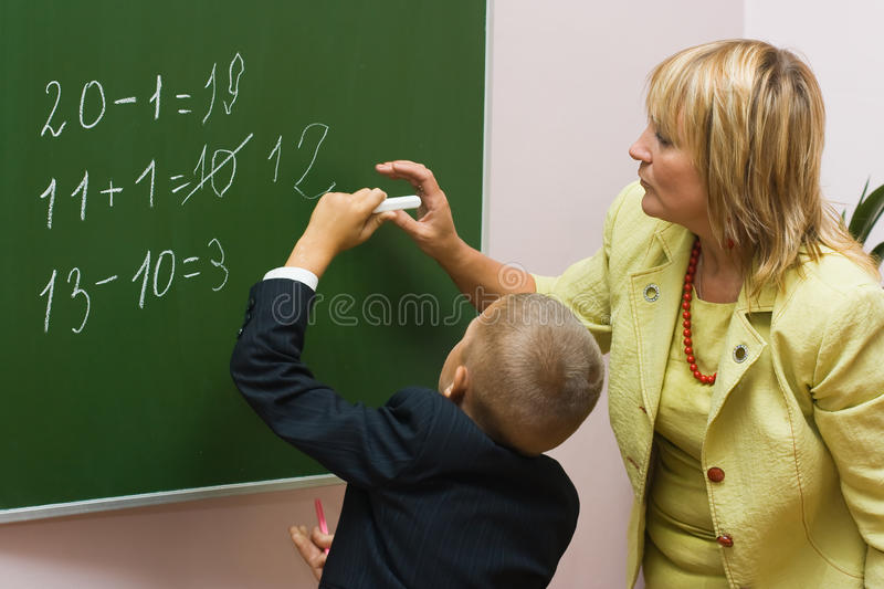 The pupil with the teacher at a mathematics lesson stock photo