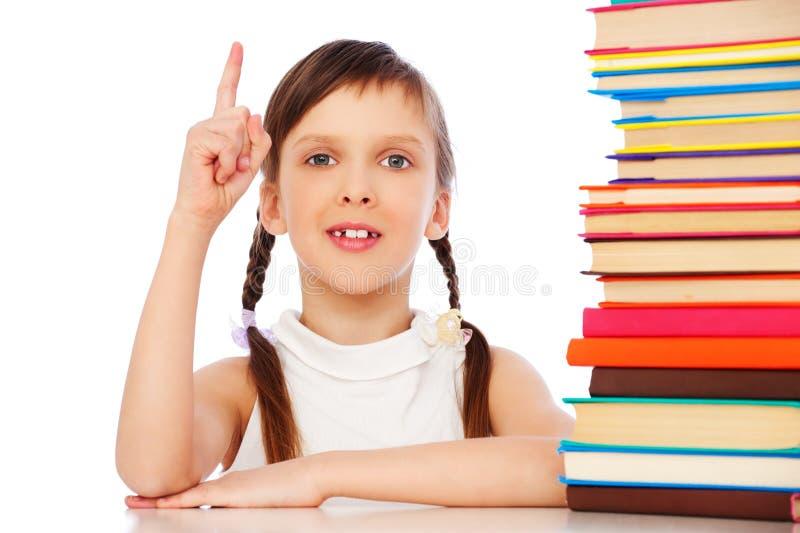 Pupila com os livros sobre o fundo branco fotos de stock