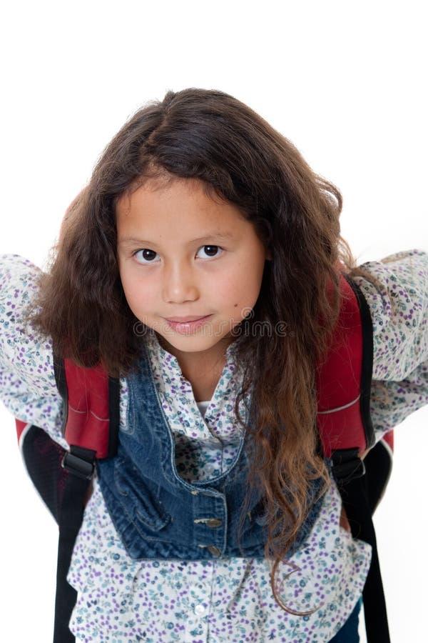 Pupila con la cartera imagen de archivo libre de regalías