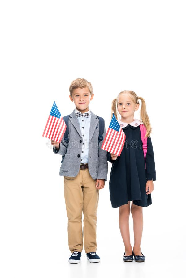 Pupils with american flags. Smiling pupils with american flags isolated on white royalty free stock photography
