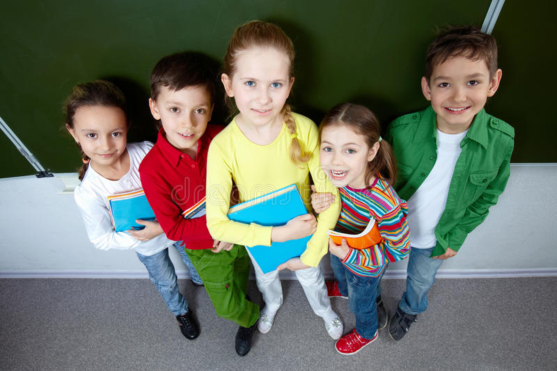Pupils with books stock photos